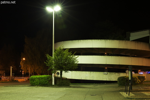 Night light on the spiral parking of Galeries Lafayette in Annecy