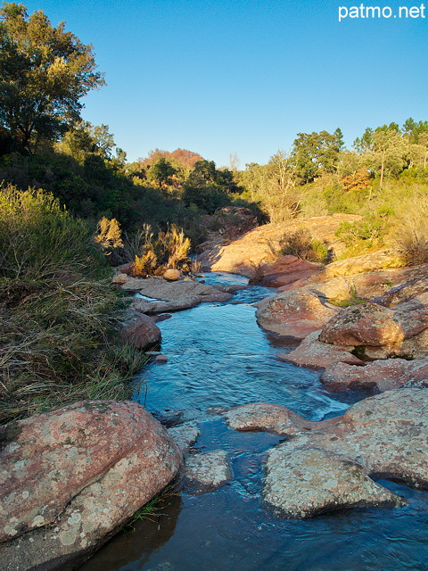 Picture of a winter stream under blue sky in La Plaine des Maures