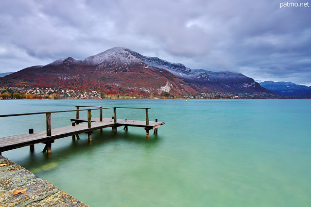 Picture with Annecy lake, Veyrier mountain and first autumn snow