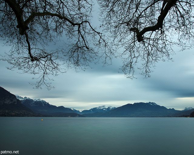 Picture of a cloudy sky over Annecy lake at the end of autumn