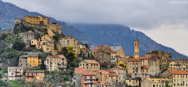 Image of the old city of Corte under the clouds of a winter morning