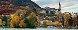 Photo of Annecy and its lake with autumn colors