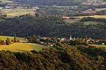 Photograph of the hills around Musièges village bathed in the evening light
