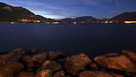 Image of Annecy lake and the mountains at the end of the night
