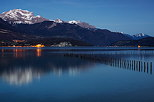 Photo of Annecy lake and Tournette mountain by a springtime dusk in Sevrier