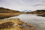 Image of lake Potron and Aiguilles d'Arves mountains in autumn