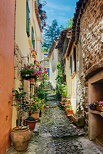 Image of a narrow  and colorful street in Collobrieres village - Provence