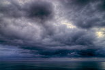 HDR photograph of a stormy sky over the Mediterranean sea in Corsica