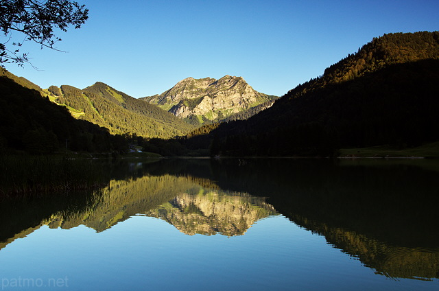 Image of lake Vallon with Roc d'Enfer mountain reflection