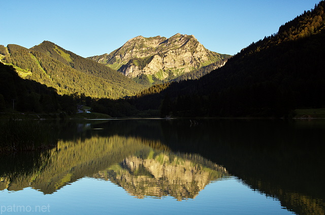 Photograph of lake Vallon in Bellevaux and Roc d'Enfer mountain
