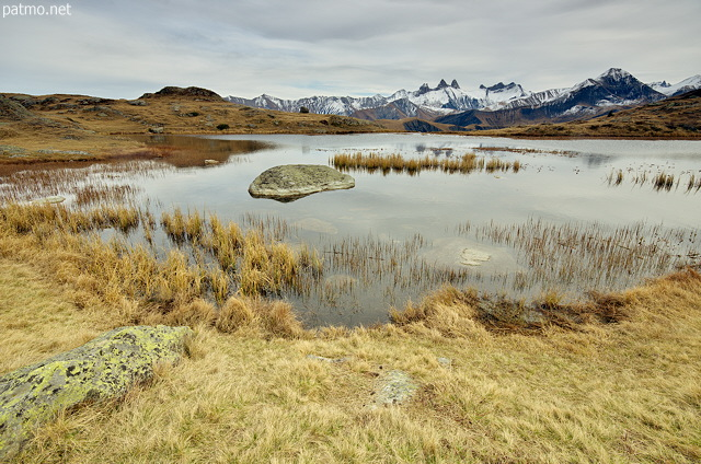 Photograph of lake Guichard and Aiguilles d'Arves mountains in autumn