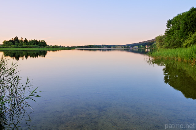 Image of Abbey lake in french Jura at dusk time