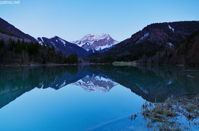 Picture at blue hour of Vallon lake and Roc d'Enfer mountain in Bellevaux