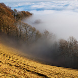 Photo of Vuache mounatin with winter mist and clouds