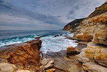 Landscape of the Mediterranean coast with waves and colorful cliffs