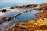 Image of rock pools on the Mediterranean coast at Bau Rouge beach in Carqueiranne