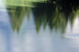 Photo of trees reflected on the water of Vallon lake