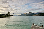 Image of Annecy lake and mountains by a windy summer day in Saint Jorioz