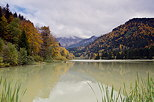 Image of lake Vallon under a cloudy sky and surrounded by the autumn forest