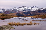Image of an autumn dusk on Aiguilles d'Arves mountains and lake Guichard