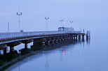 Photo of Geneva lake under dusk light in the pier of Thonon les Bains.