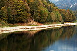 Photograph of colorful autumn trees around the lake in Montriond