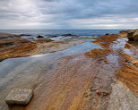 Image of the mediterranean sea under a cloudy sky at Bau Rouge beach in Provence
