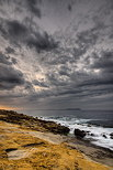 Image of the mediterranean coast under a stormy sky