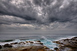 Photo of the mediterranean coast under an impressive cloudy sky